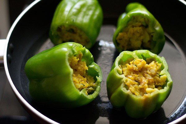 place the stuffed capsicum in the pan