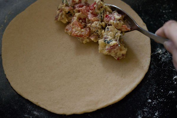 add filling - making calzone recipe