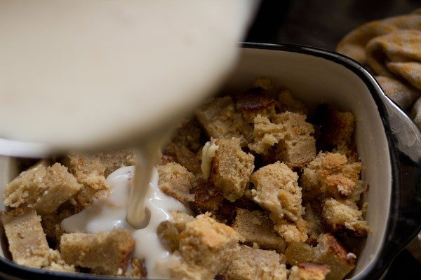 pour mixture - preparing bread butter pudding recipe