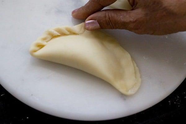 pleating the edges of the karanji
