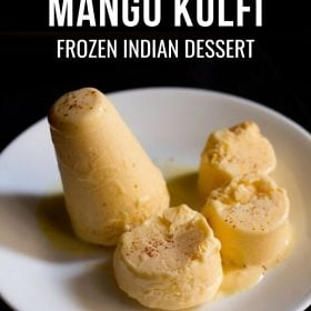mango kulfi sliced and whole on a white plate with a text layover