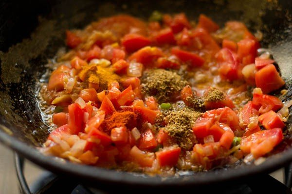 adding spices - preparing matar mushroom