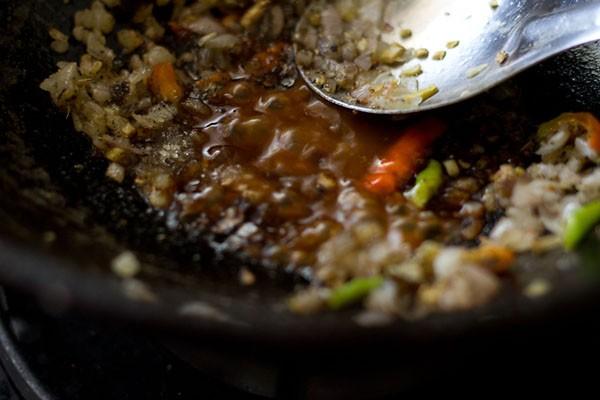 add sauce - making schezwan chilli potatoes recipe