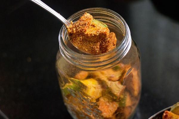 add mango pickle mixture in a jar