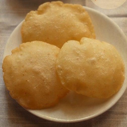 rice pooris recipe, tandalache vade recipe, rice poori recipe with rice flour
