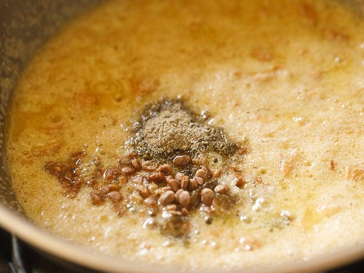 adding raisins and cardamom powder