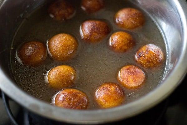 fried gulab jamun balls added into sugar syrup