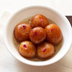 gulab jamun served in a white bowl