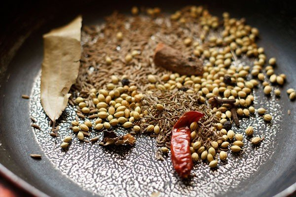 roast spices to make vangi bhaat