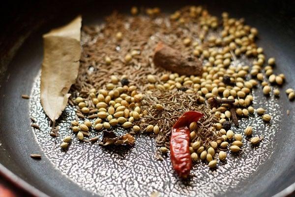 roast spices to make vangi bhaat