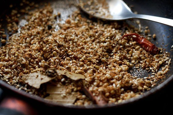 roasting desiccated coconut in a pan