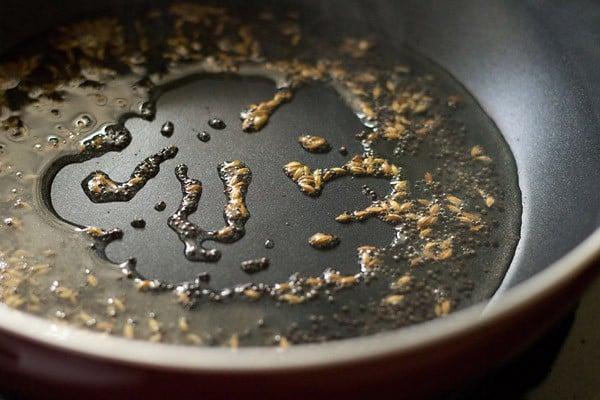 heat oil - making vangi bhaat