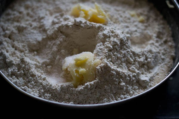 add butter to naan mixture