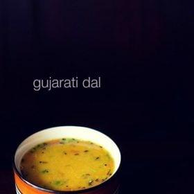 Gujarati dal in a black rimmed ceramic bowl on a black background