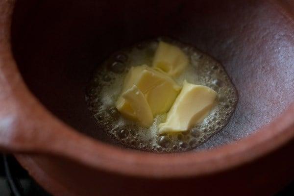 melting butter to prepare veg handi recipe