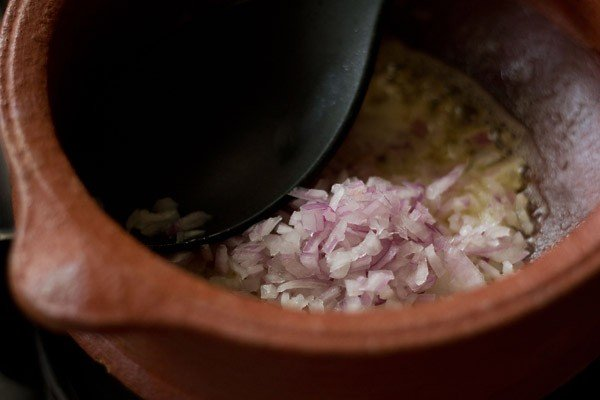 adding chopped onions for veg handi recipe