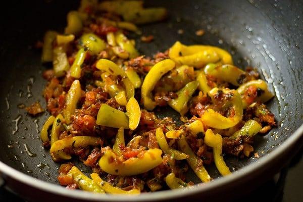 add capsicum - making veg kolhapuri recipe