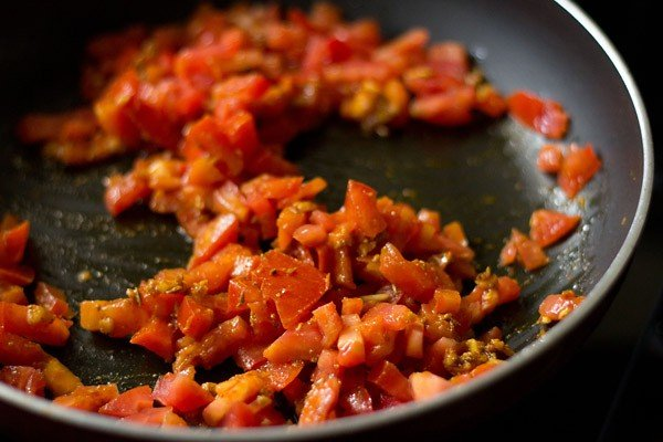 add tomatoes - making aloo rasedar recipe