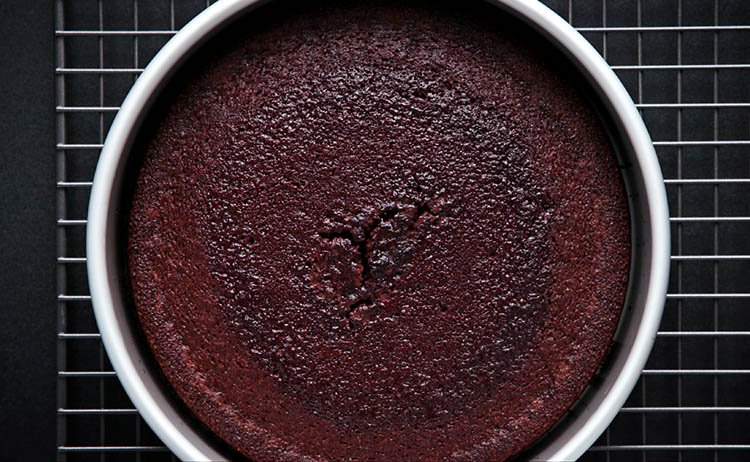 eggless chocolate cake in a tin after being baked
