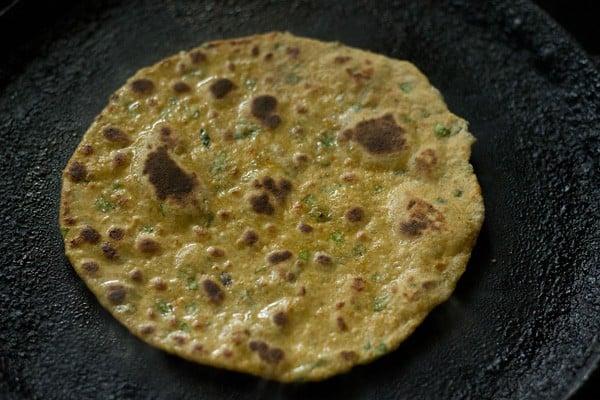 cooked vegetable paratha on tawa