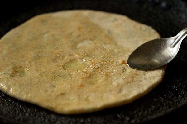 frying aloo kulcha