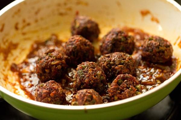 adding veg manchurian balls