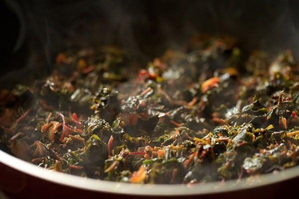 cooking tambdi bhaji