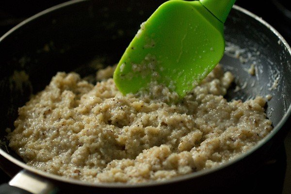 stir coconut ladoo mixture