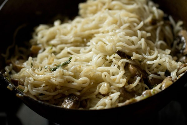 adding noodles to make mushroom noodles recipe