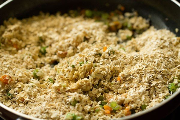 oat and vegetable mixture being combined in saucepan