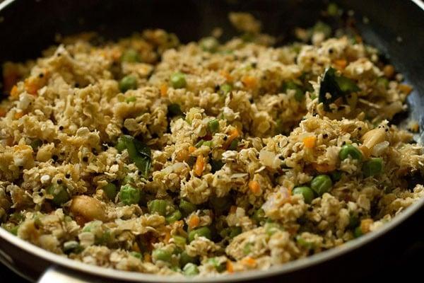 oat and vegetable mixture cooking in saucepan