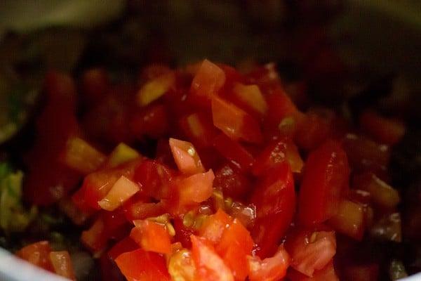 adding tomatoes for pulao recipe