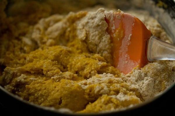 folding eggless mango cake batter