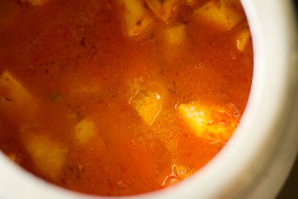 water for aloo tamatar jhol recipe