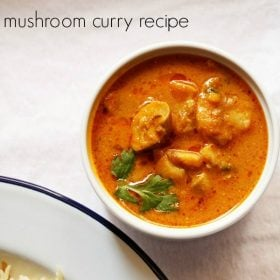 mushroom masala garnished with coriander sprigs in a white bowl on a white board