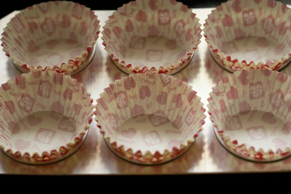 muffin liners on a baking tray
