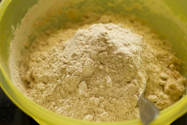 adding flour for making pav dough