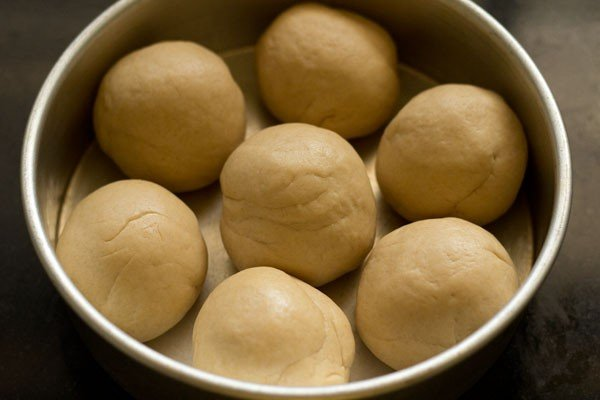dough ball in a well greased pan