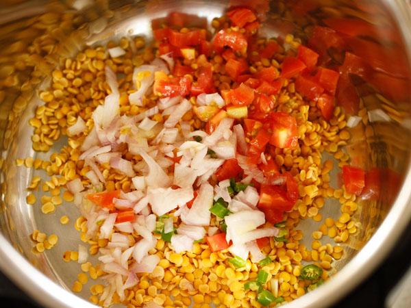 added chopped onions, tomatoes, green chillies in instant pot