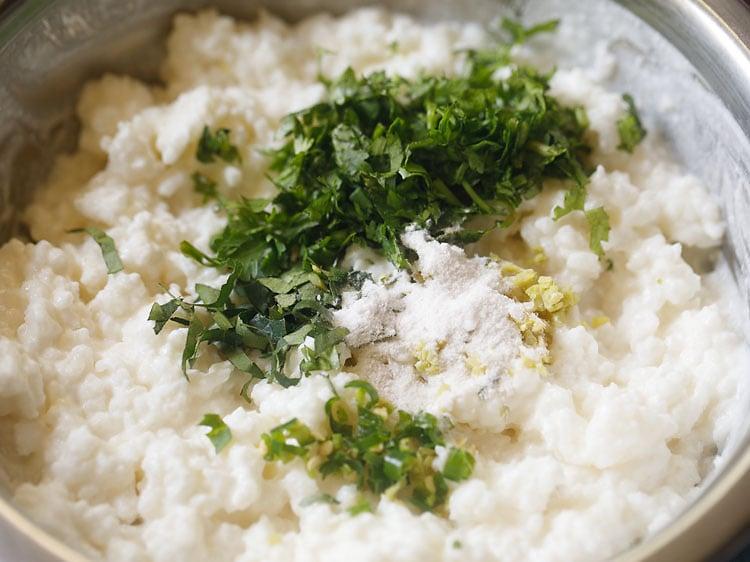 adding salt in curd rice mixture