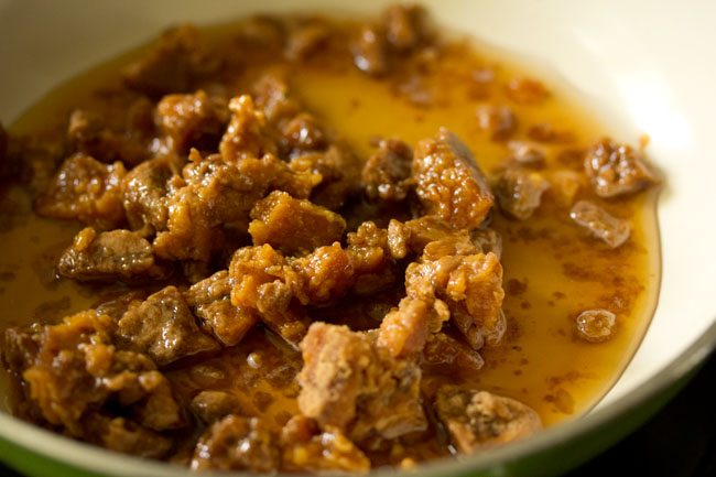 chopped jaggery and water in a frying pan