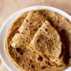 broccoli paratha served on a white plate