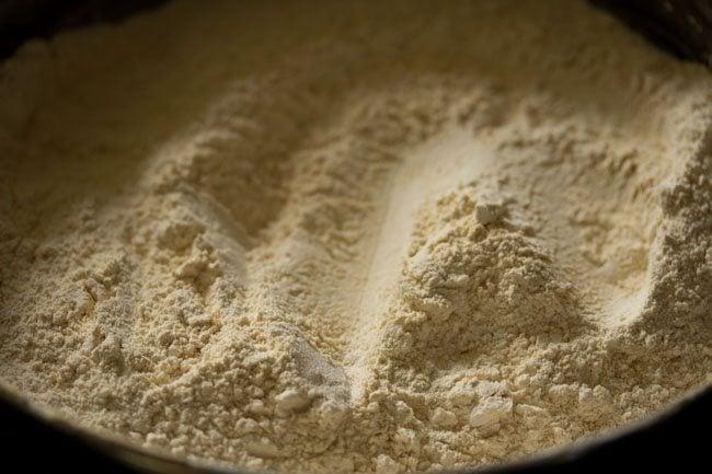 preparing moong dal laddu recipe