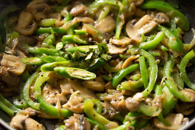 making preparing mushroom pepper fry recipe