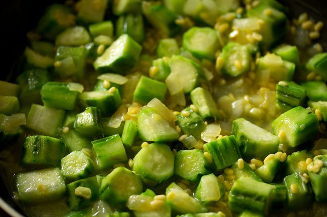 preparing ridge gourd bhaji recipe