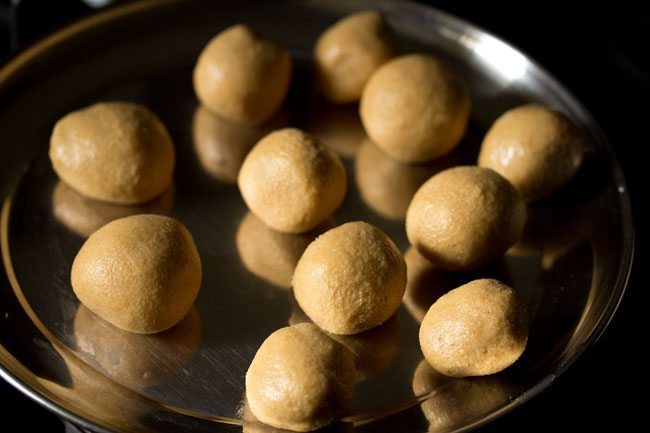 preparing urad dal ladoo recipe