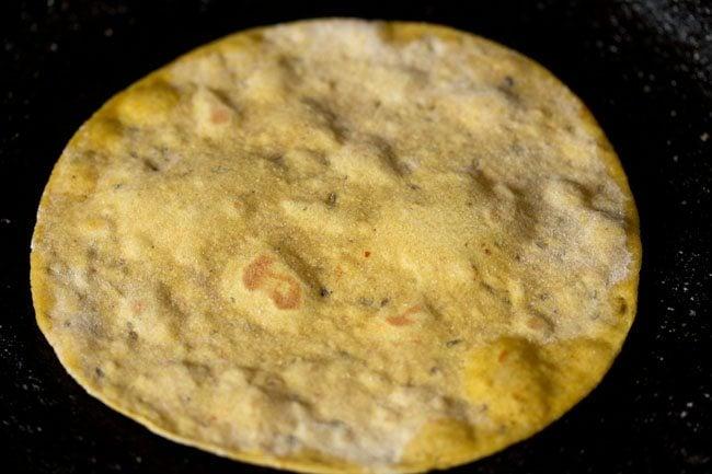 frying paratha for making masala paratha recipe
