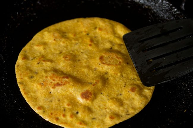 frying paratha for preparing masala paratha recipe