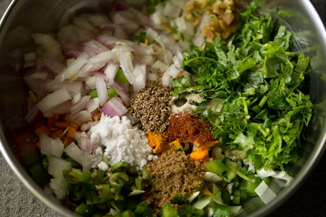 spices and seasonings added to mix vegetables