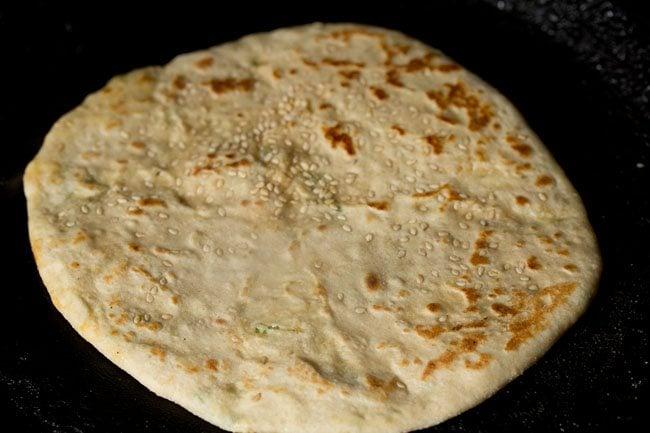 frying stuffed kulcha - paneer kulcha recipe